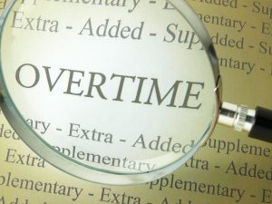 """The word """"overtime"""" seen through a magnifying glass"""