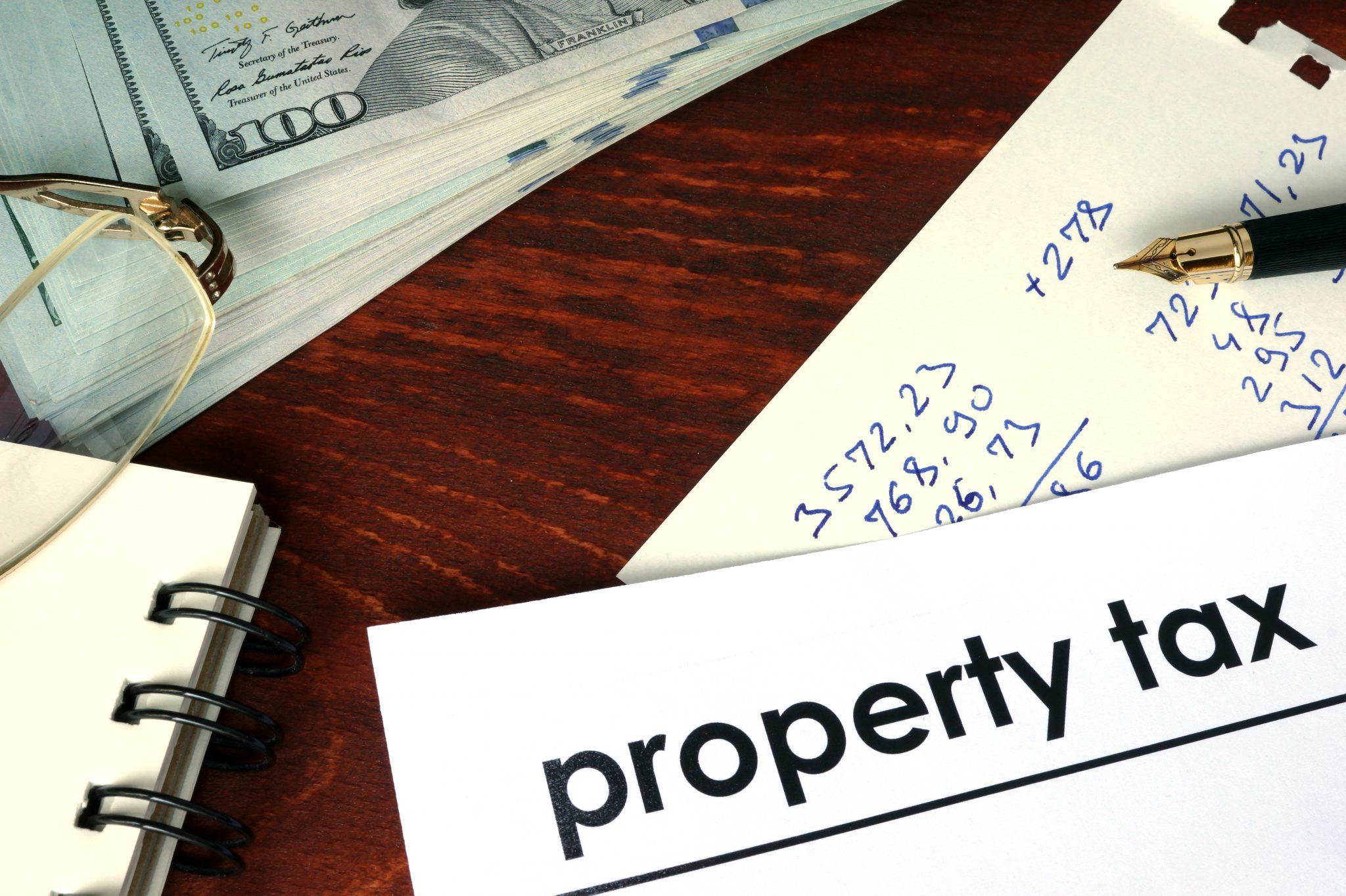 Property tax written on a paper. Financial concept