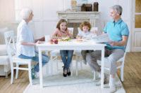 grandparent custody - Friendly family of four having their meal