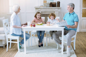 grandparent custody - Friendly family of four having their meal